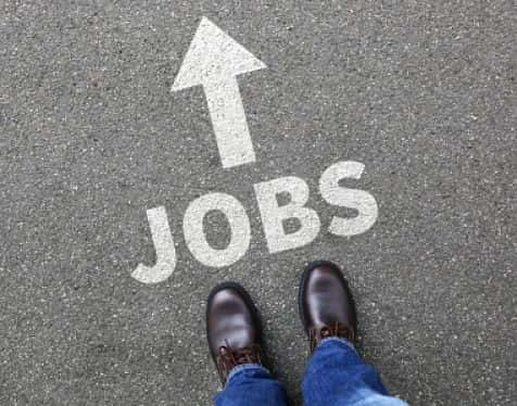 """feet in front of sign reading """"jobs -->"""" (boarding1now/Thinkstock)"""