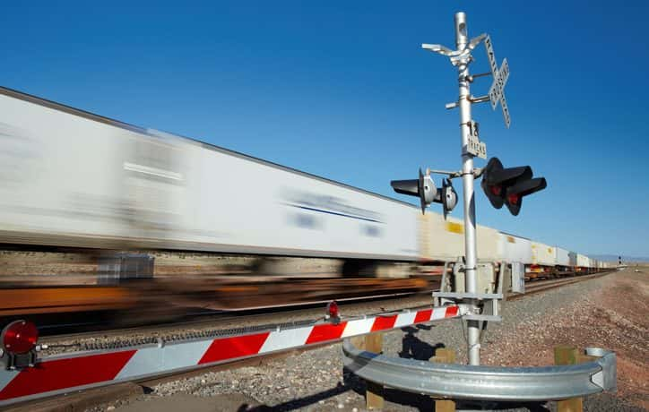 moving train at railroad crossing