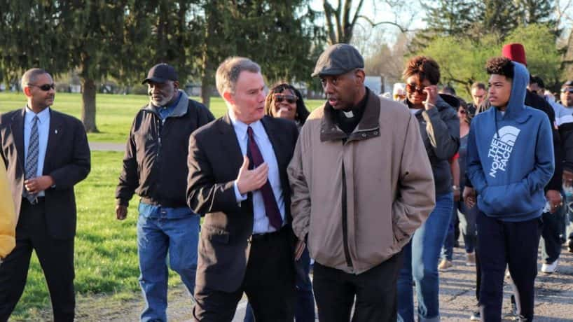 Rev. Charles Harrison of Indy Ten Points Coalition walks with Indy Mayor Joe Hogsett