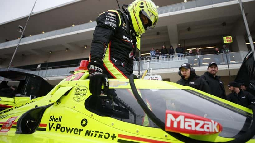 Simon Pagenaud getting in his car