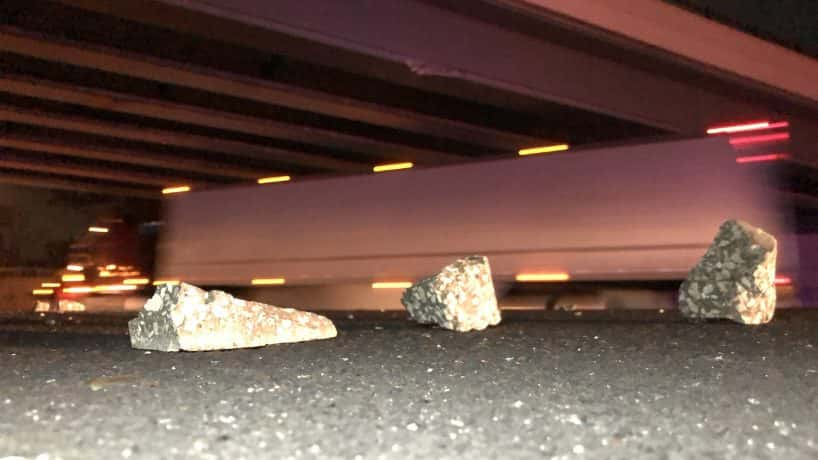Chunks of concrete on I-465 underneath the 75th Street bridge