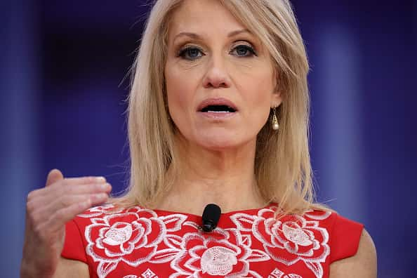 White House adviser Kellyanne Conway gestures while participating in a conversation with Republican pundits.