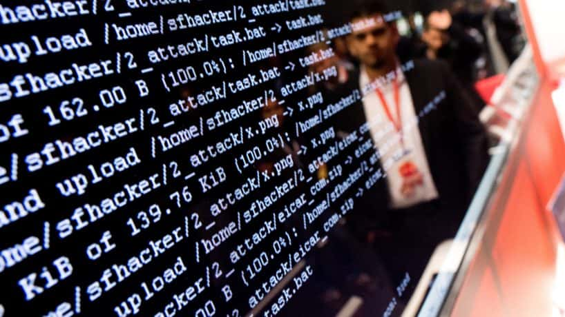 Lines of computer code onscreen in hacking demonstration