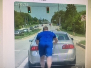 A photo of a video the Indianapolis Colts took of Mark Glowinski pushing a man's car to a gas station