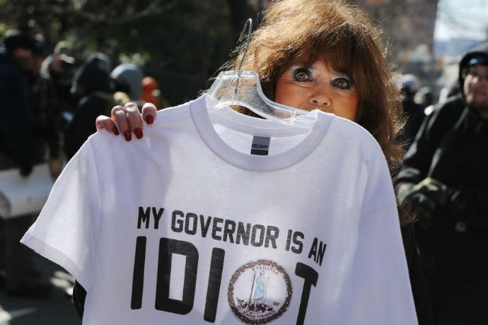 A vendor sells t-shirts on the street outside a gun rights rally organized by The Virginia Citizens Defense League on Capitol.