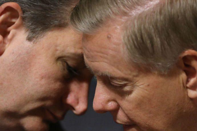 WASHINGTON, DC - SEPTEMBER 28: Senate Judiciary Committee members Sen. Ted Cruz (R-TX) and Sen. Lindsey Graham (R-SC) talk durin