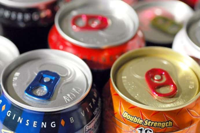 The tops of various energy drink cans that are sold at stores in the U.S.