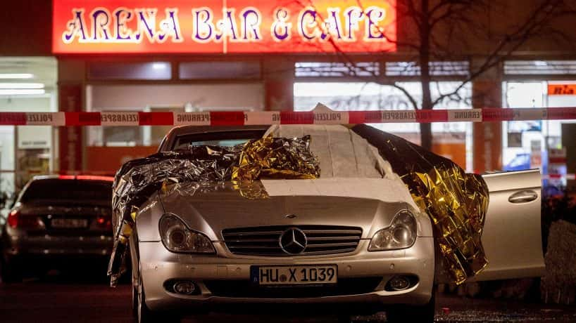 Car with shattered glass outside one of the bars