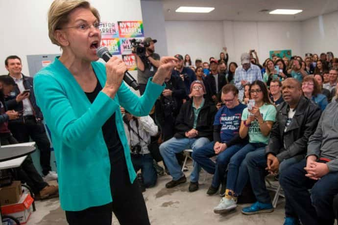 Elizabeth Warren speaks to a crowd at a Nevada campaign event. Warren smeared law enforcement Thursday, implying that police officers are racist.