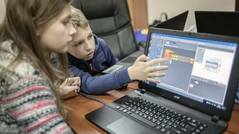 kids looking at laptop