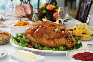 Turkey and other Thanksgiving food on a table.