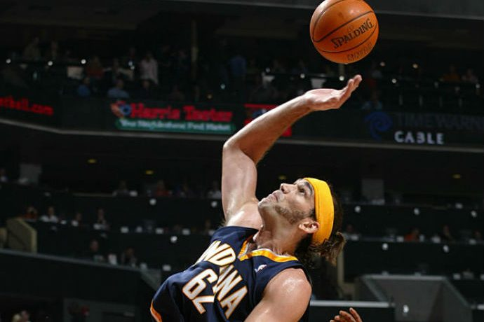 Nov 16, 2005; Charlotte, NC, USA; SCOT POLLARD of Indiana and KEVIN BURLESON of Charlotte during the Indiana Pacers.