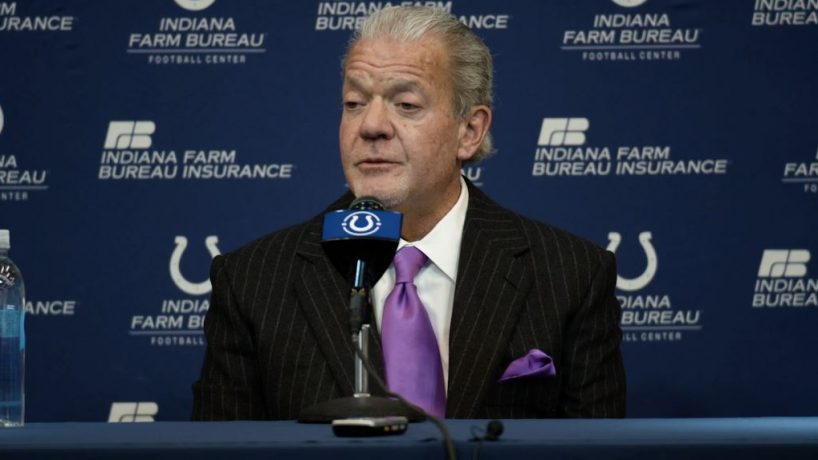 Colts owner Jim Irsay sitting at a table, talking at Sunday's press conference