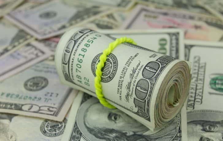 rolled up hundred dollar bills