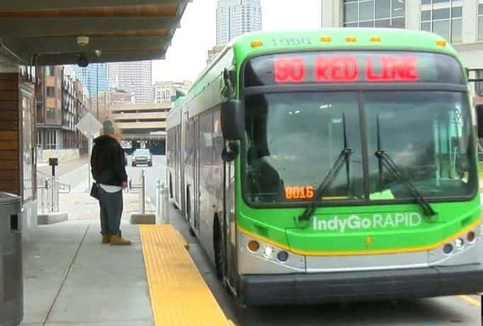 An IndyGo Red Line bus pulling up to a bus stop