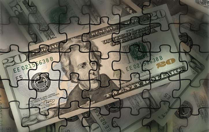 A $20 bill made of jigsaw puzzle pieces.