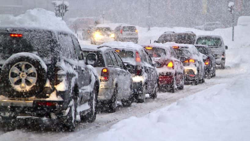 Cars stuck in traffic during a snowstorm
