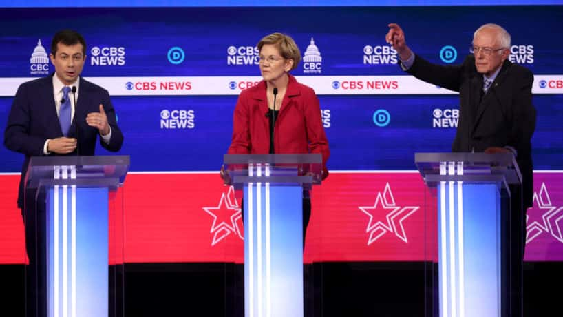 Pete Buttigieg, Elizabeth Warren, and Bernie Sanders on the debate stage