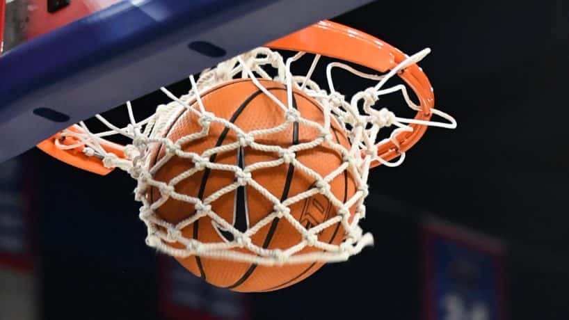 Photo of basketball going through a hoop - Photo from Getty Images and Icon Sportswire