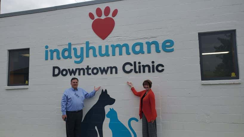 IndyHumane CEO David Horth and Pulliam Rep standing outside IndyHumane Downtown Clinic sign.