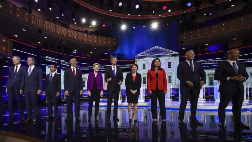 Nominees for the NBC debate nights gather on the stage for a group photo before the event.
