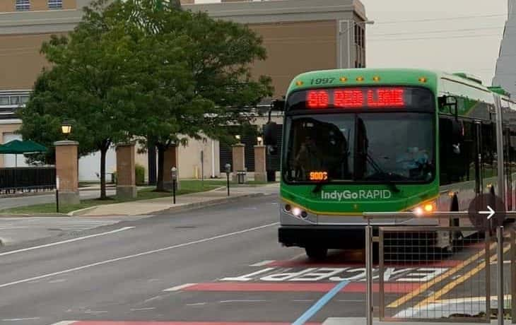 An IndyGo Red Line bus picks up passengers in downtown Indianapolis.