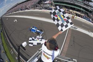 Takuma Sato crosses the finish line to win the Indianapolis 500.