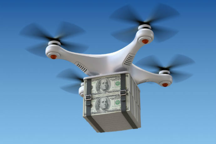 A drone prepares to drop money from the sky. Helicopter Money is about to be used to save the U.S. economy.