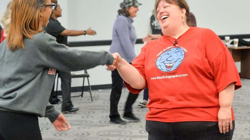 A photo of two people laughing during a laughter session at the University of Indianapolis