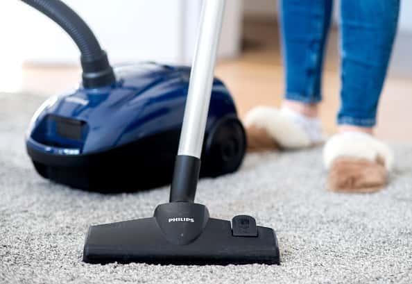 A vacuum on grey carpet