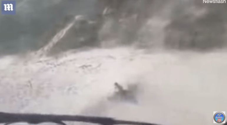 Helicopter Blows Sands on Beachgoers