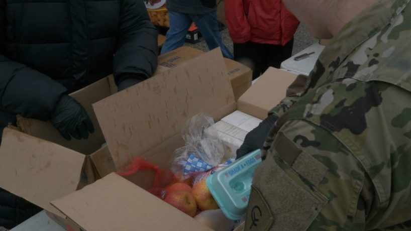 Woman from Indiana National Guard packing food