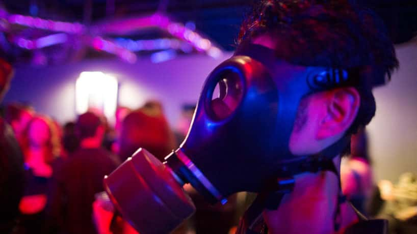 A man wears a gas mask at a dungeon party during the domination convention, DomCon LA, on May 16, 2015 in Los Angeles, California. The annual convention, which was started in 2003 by fetish professional Mistress Cyan, brings together enthusiasts of BDSM and other fetishes. (Photo by David McNew/Getty Images)
