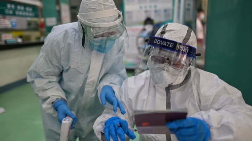 Medical workers check information as they take swab samples from people to be tested for the COVID-19 novel coronavirus in Wuhan, China's central Hubei province on April 16, 2020. - China has largely brought the coronavirus under control within its borders since the outbreak first emerged in the city of Wuhan late last year. (Photo by Hector RETAMAL / AFP) (Photo by HECTOR RETAMAL/AFP via Getty Images)