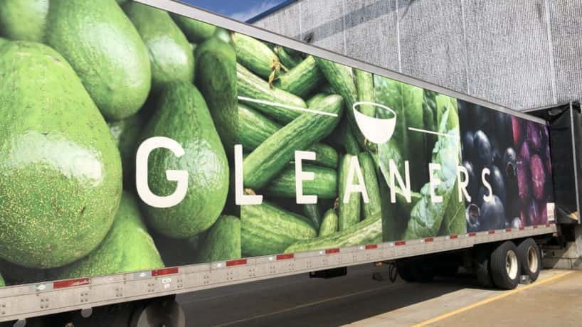 Gleaners semi with green vegetables on the side.