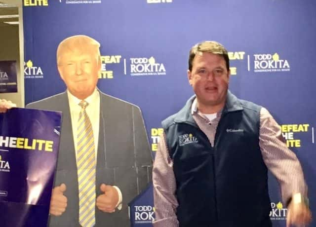 Indiana Republican Todd Rokita Stands Next to a Cardboard Standup of President Donald Trump.