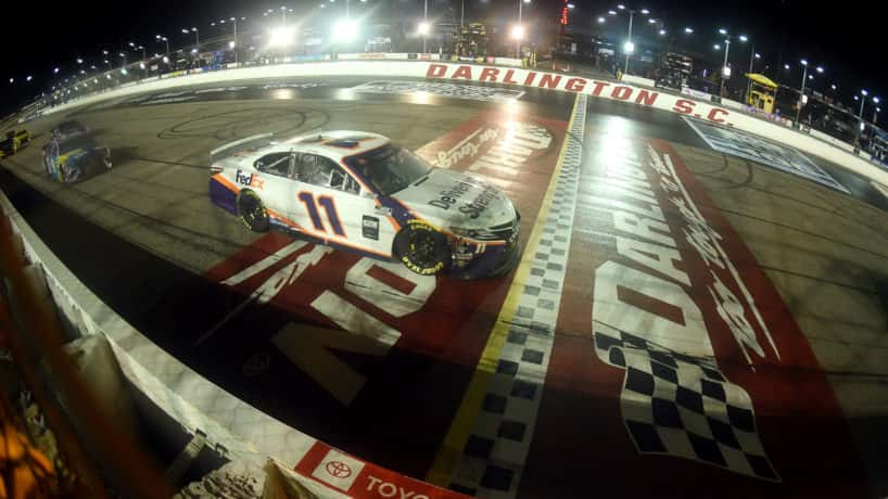Denny Hamlin crossing the start-finish line