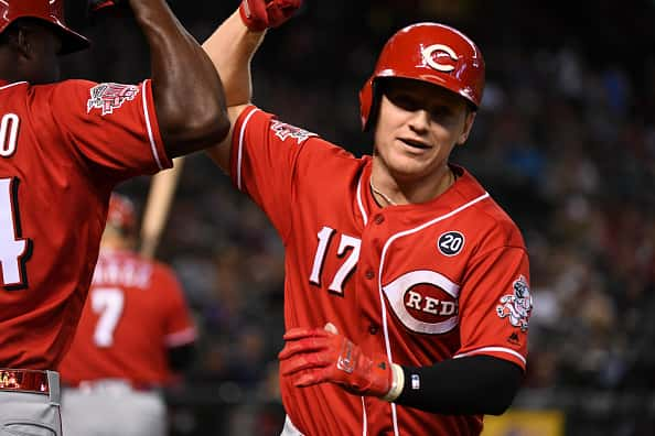 Josh VanMeter #17 of the Cincinnati Reds celebrates with Aristides Aquino #44 after hitting a solo home run