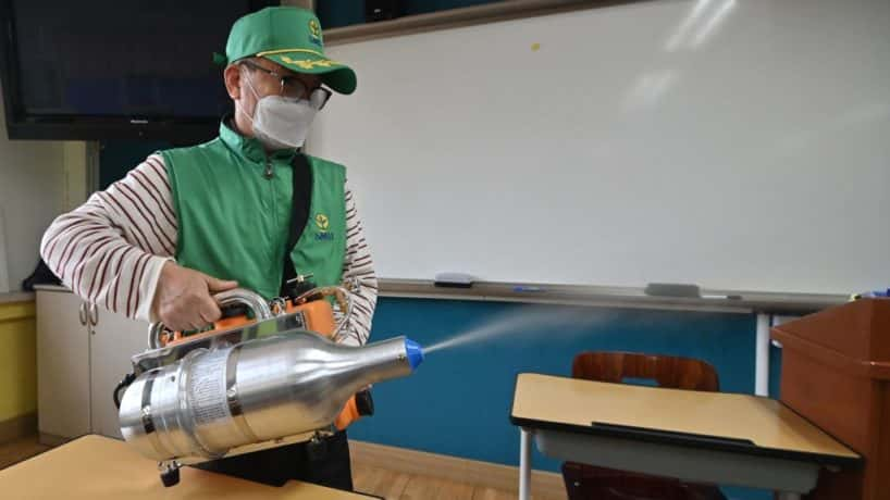 Man disinfecting classroom in South Korea