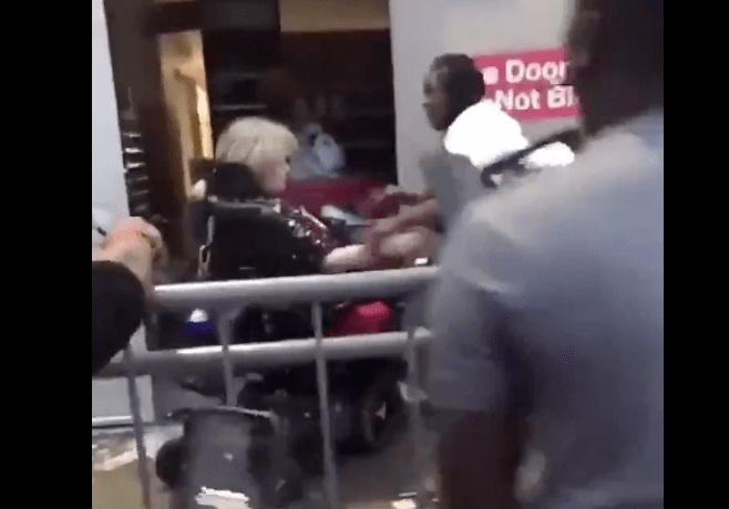 Protestors attack old woman in wheelchair holding a knife