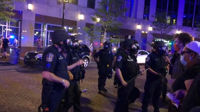 Cops and protesters in Indy