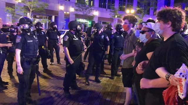 Cops and protesters confront each other