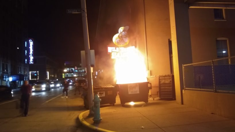 A photo of a dumpster on fire outside the Wild Beaver