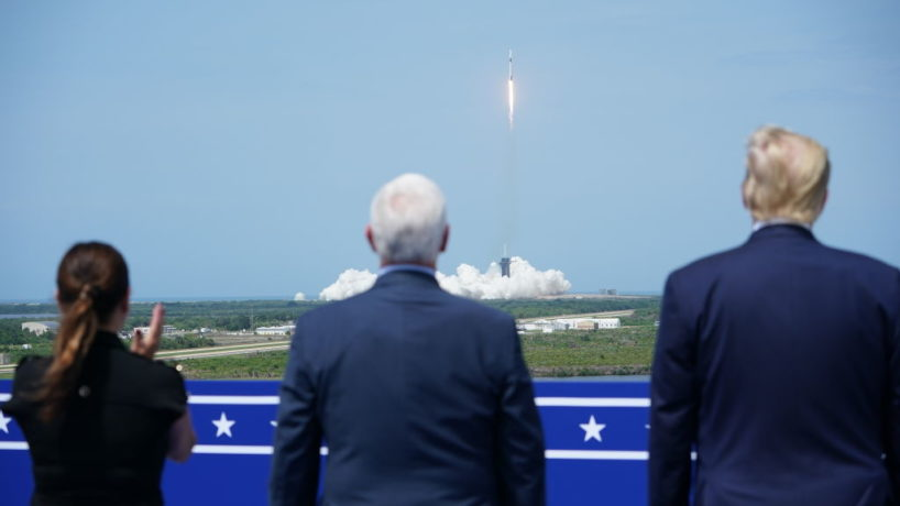 Karen Pence, Mike Pence, and Donald Trump looking on at rocket launch