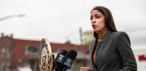 Representative Alexandria Ocasio Cortez (D-NY) speaks at a press conference at Corona Plaza in Queens on April 14, 2020 in New York City. Ocasio-Cortez was joined by Senate Minority Leader Chuck Schumer (D-NY) at the conference, where both called for the Federal Emergency Management Administration to fund funeral costs in low-income communities of color during the ongoing amid the coronavirus pandemic. (Photo by Scott Heins/Getty Images)