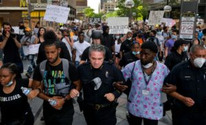Denver Police Chief Paul Pazen links arms with people protesting the death of George Floyd on June 1, 2020 in Denver, Colorado. Protests continue in cities across the country after Floyd, a black man, died in police custody in Minneapolis on May 25. (Photo by Michael Ciaglo/Getty Images)