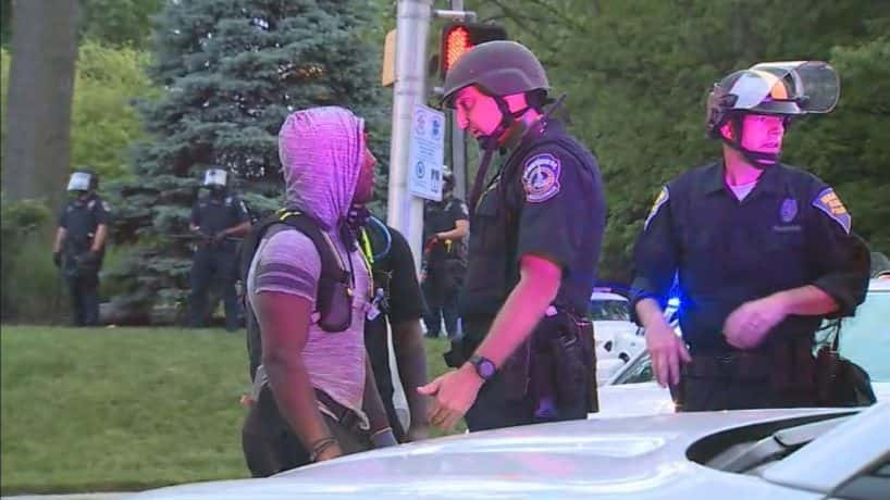 Protest leader and police officer talking