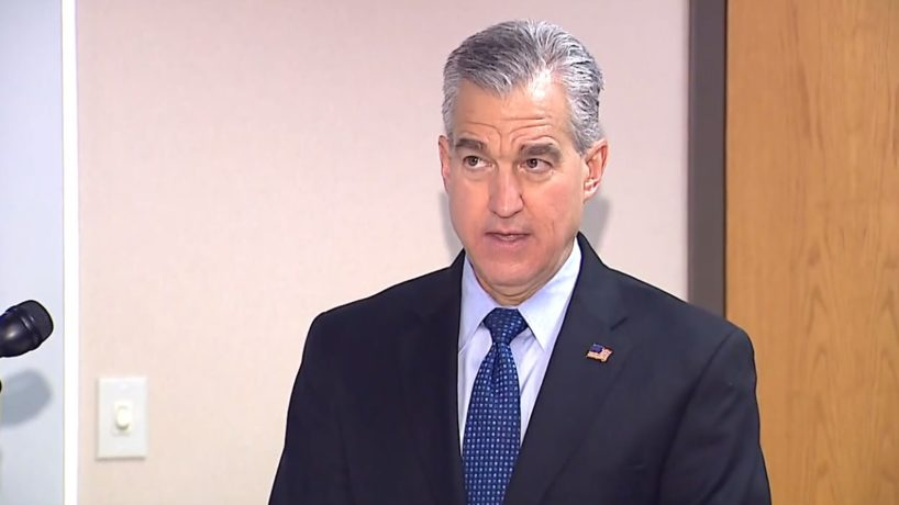 A photo of U.S. Attorney Josh Minkler speaking at a press conference