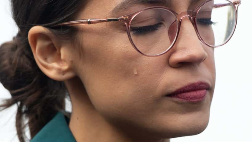 US Representative Alexandria Ocasio-Cortez, Democrat of New York, sheds a tear during a press conference calling on Congress to cut funding for US Immigration and Customs Enforcement (ICE) and to defund border detention facilities, outside the US Capitol in Washington, DC, February 7, 2019. (Photo by SAUL LOEB / AFP) (Photo by SAUL LOEB/AFP via Getty Images)