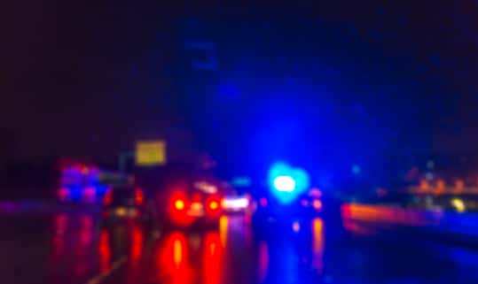 lighting of police car in the night during accident -blurred.